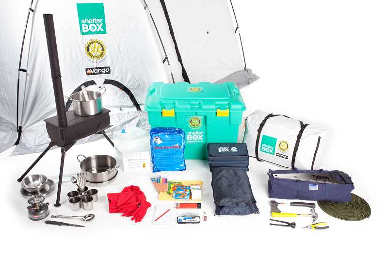 by: COURTESY OF SHELTERBOX - A basic ShelterBox contains not only a tent but also a small stove, water purification equipment, cooking utensils and other items.
