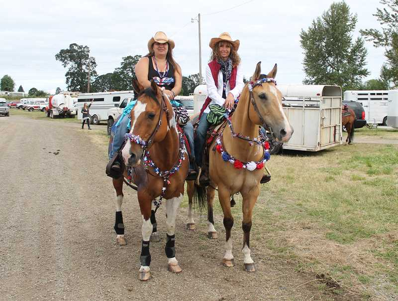 by: JIM BESEDA/MOLALLA PIONEER - Molalla's Jennifer Hepler and Woody (left) along with Kim Krupicka and Spartan show off their patriotic spirit before Sunday's Molalla Buckeroo Trail Ride.