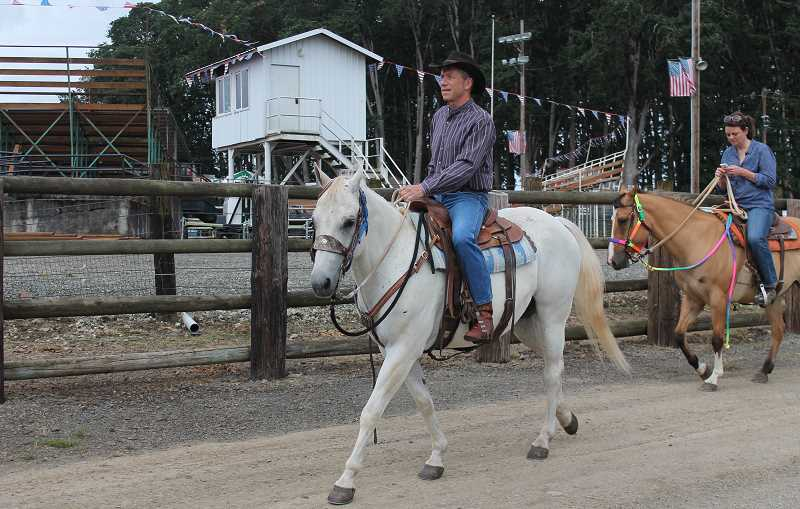 by: JIM BESEDA/MOLALLA PIONEER - Congressman Kurt Schrader was among the first riders out during Sunday morning's Molalla Buckeroo Trail Ride.
