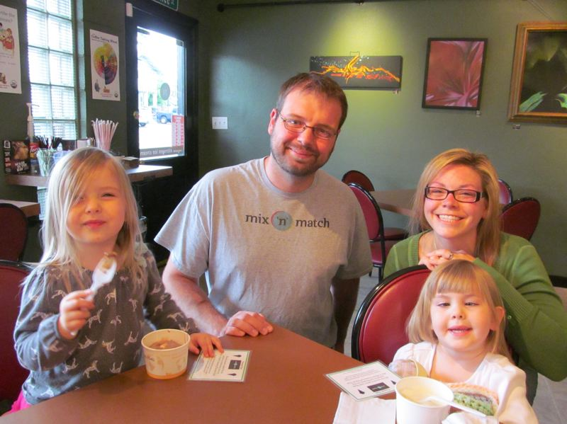 by: PHOTO BY ELLEN SPITALERI - Enjoying free ice cream with marshmallows are Norah, 2, far left, and Leah Merklin, 4, while Mix 'n' Match Creamery owner Eric West, center, and Bethany Merklin, the girls mother, look on.