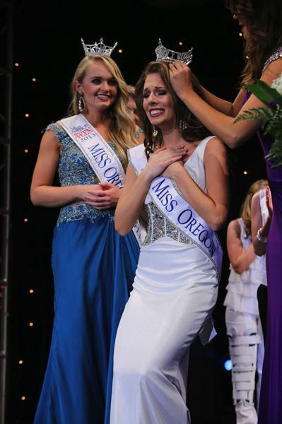 by: PHOTO BY: JOE WHITEKO - Miss Oregon 2014 Rebecca Anderson of Oregon City is crowned last weekend as Harley Emery looks on.