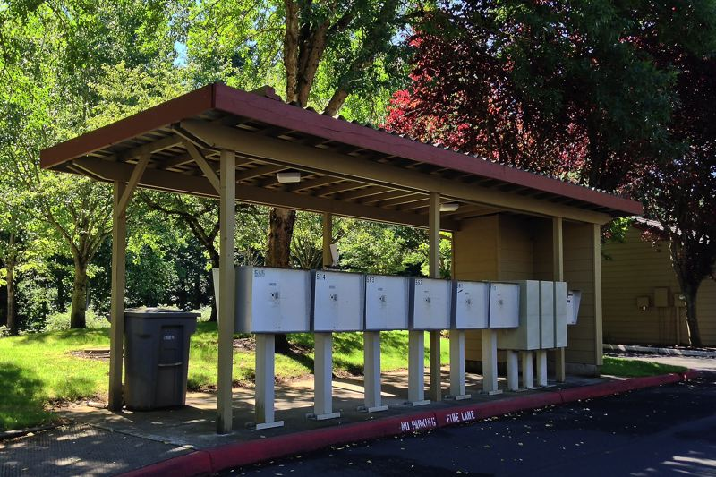 by: SPOKESMAN PHOTO: JOSH KULLA - Wilsonville Police are investigating a series of thefts from mailboxes at local apartment complexes, including this one at the Hathaway Court Apartments on SW Wilsonville Road.