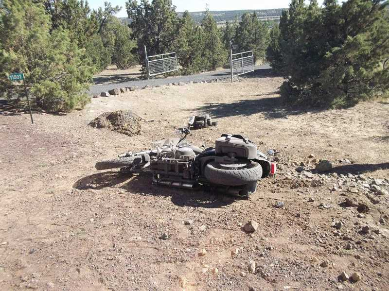 by: PHOTO COURTESY OF CROOK COUNTY SHERIFF'S OFFICE - The driver, Bryan France, was found sitting on the shoulder about 50 feet from the crashed motorcycle.