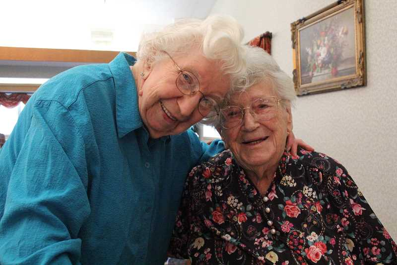 by: LINDSAY KEEFER - Lill Nicholas (right) turned 100 last week. She is pictured with Cascade Park Retirement Community's oldest resident, Mary Seely, who turns 101 this month.