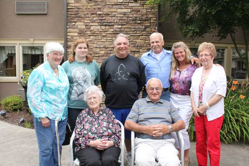 by: LINDSAY KEEFER - Lill Nicholas (seated, left) posed for a family photo in Cascade Park's courtyard with members who visited her for lunch on her birthday, including (seated) her son William 'Nick' Nicholas, (standing, from left) daughter-in-law Dolores, great-granddaughter Maylin, grandsons Craig and Todd Nicholas, Todd's wife Dawn and daughter-in-law Kay Nicholas.