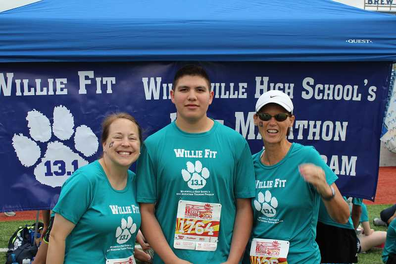 by: SUBMITTED PHOTO - Armando Lopez, center, was the only four-year member of Willie Fit this year. A club participant every year of his high school career, he poses here with advisers Alyson Leatherman, left, and Lyndi Tucker after completing the Helvetia Half Marathon June 7.