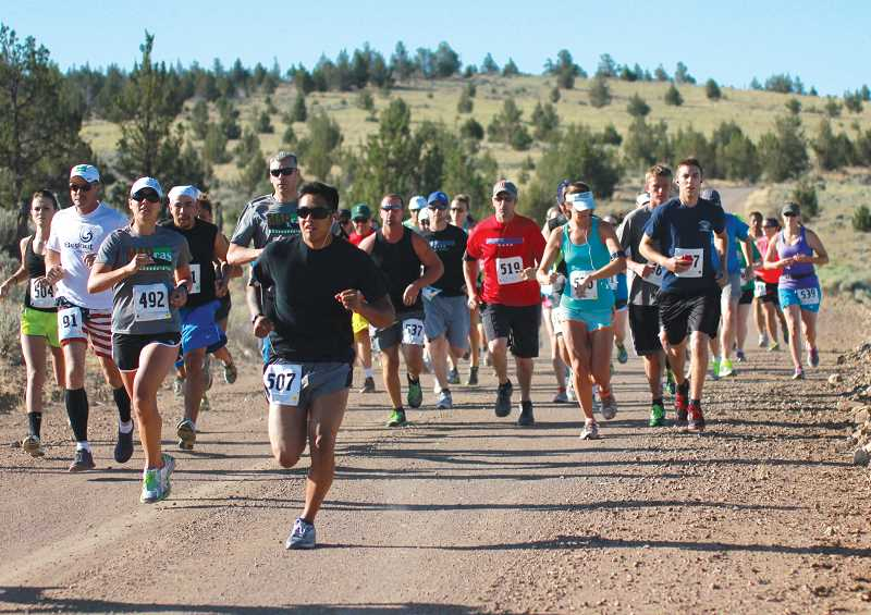 by: PIONEER FILE PHOTO - Runners hit the road at the start of last year's Todd Beamer run. This year's run is Friday.