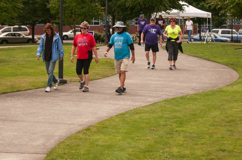 by: SPOKESMAN PHOTO: JOSH KULLA - Walkers wind their way through Town Center Park as part of Wilsonville's 2014 Relay for Life.
