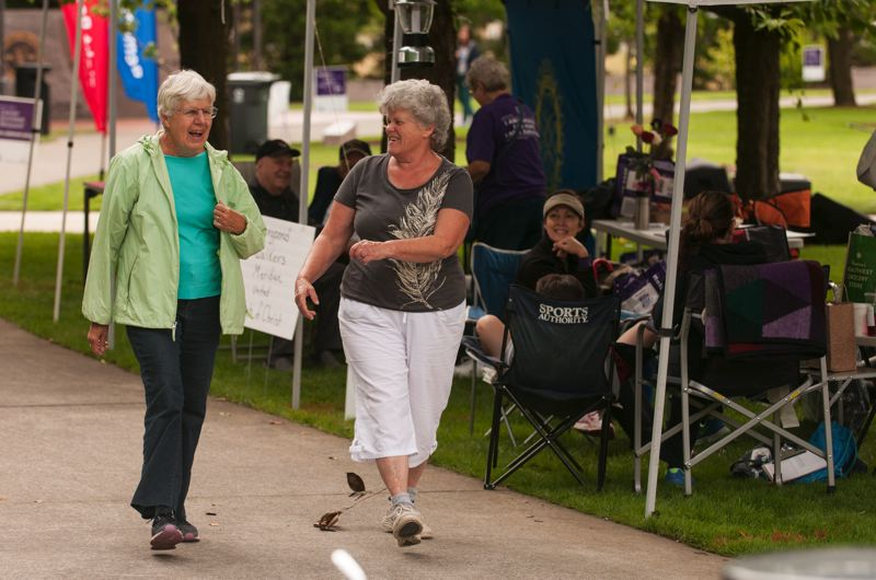 by: SPOKESMAN PHOTO: JOSH KULLA - These walkers enjoy a laugh Saturday morning during the Wilsonville Relay for Life at Town Center Park.
