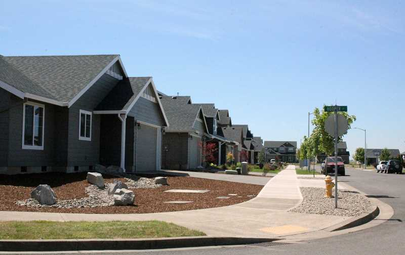 by: TYLER FRANCKE | WOODBURN INDEPENDENT - One of the city's newest residential developments, Paradise Pointe, is seen Monday. A project of Icon Development, several homes in the subdivision are currently under construction.