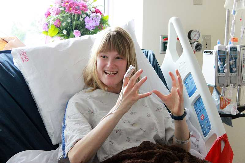 by: NEWS-TIMES PHOTOS: KATE STRINGER - Kylie Marble, a member of the Forest Grove High School Class of 2010, smiles from her hospital bed at Oregon Health & Science University. The 21-year-old college student is recovering from a rare bacterial infection that nearly took her life.