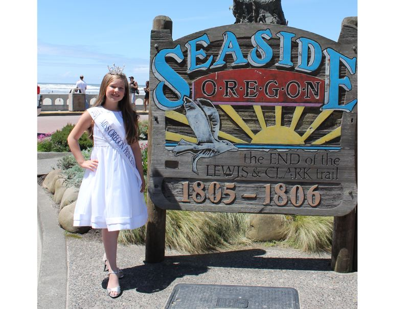 by: SUBMITTED PHOTO - Deja Fitzwater celebrates her achievement as the newly crowned Miss America Oregon Princess at Seaside.