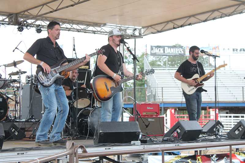 by: JIM BESEDA/MOLALLA PIONEER - Oregon City-based country band Country Wide was among the four bands that provided entertainment at Saturday's 91st Molalla Buckeroo Rodeo Kickoff Party at the rodeo grounds.