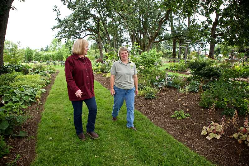by: PAMPLIN MEDIA GROUP PHOTO: JAIME VALDEZ  - Mary Stewart (right), an agritourism consultant, walks with Carol Westergreen on the grounds of Westergreens Out in the Garden Nursery in Molalla.The nursery welcomes guests as part of the Molalla Country Farm Loop.