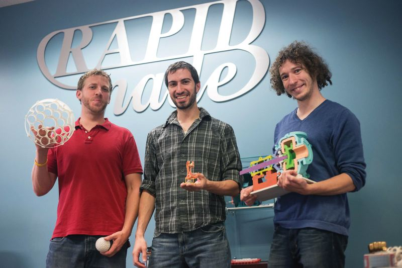 by: TRIBUNE PHOTO: JONATHAN HOUSE - From left, Kristofer Beem, David Shapiro and Micah Chaban show off some of the products made by their 3D printing firm, RapidMade.