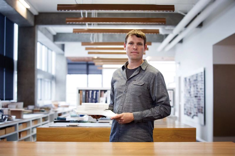 by: TRIBUNE PHOTO: JONATHAN HOUSE - Robert Petty, associate partner and director of ZGF Architects model shop, holds a 3D-printed shapeused in an architectural model. 3D printing allows architects to quickly create models for clients that once took weeks to produce by hand.