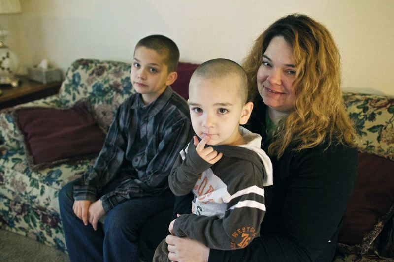 by: TRIBUNE PHOTO: JAIME VALDEZ - Rachel Henderson and her sons, Jessie, 4, and Isaac,10, found help through the Village Support Network, a program driven by the New City Initiative, which aims to involve more Portland-area churches in programs to aid homeless people.