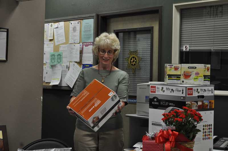 by: PHOTO COURTESY OF CCSO - Sue Ramey opens a gift during her retirement party on Monday afternoon. The civil office deputy is retiring from the Crook County Sheriff's Office after working there for the past 27 years.