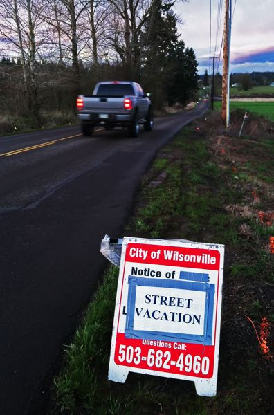 by: SPOKESMAN FILE PHOTO: JOSH KULLA - SW 110th Avenue in Villebois, shown here earlier this spring, is being closed to drivers and vacated. New roads are planned that will connect the Boeckman Bridge to the new Tonquin Meadows subdivision.