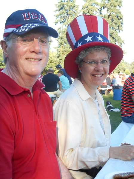 by: REVIEW PHOTO: GARY M. STEIN - Iris Walling and Mike Bliziotes of Lake Oswego don their finest patriotic garb July 4 for the Lions Club pancake breakfast in George Rogers Park.