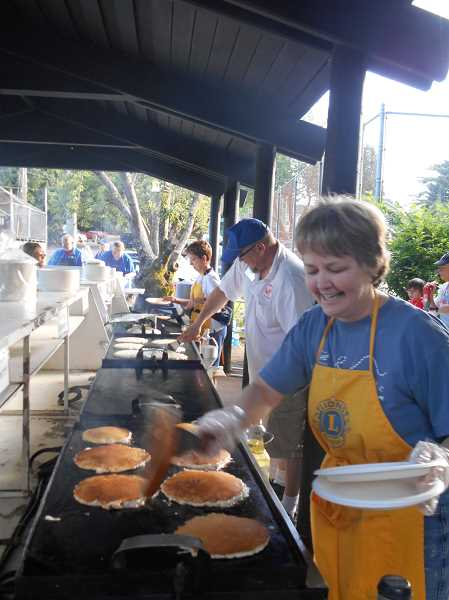 by: REVIEW PHOTO: GARY M. STEIN - Gretchen Olson flips flapjacks in George Rogers Park.