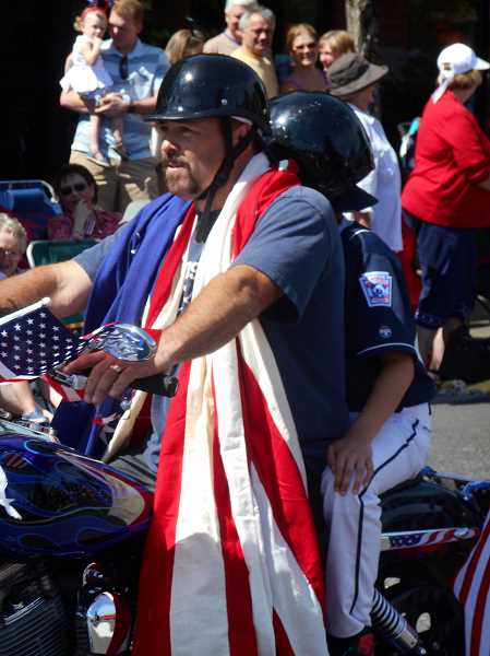 by: REVIEW PHOTO: GARY M. STEIN - Lake Oswegans celebrate the Fourth of July with a Star Spangled Parade down A Avenue.
