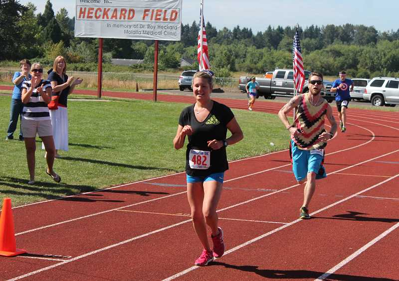 by: JIM BESEDA/MOLALLA PIONEER - Molalla's Bethani Anderson nears the finish of Friday's Freedom 5K, winning the women's race for the second time in three years.