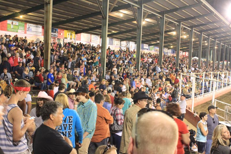 by: JIM BESEDA/MOLALLA PIONEER - An all-time record crowd estimated at between 12,000 to 13,000 watched Friday night's second of two Independence Day performances at the 91st Molalla Buckeroo PRCA Rodeo.