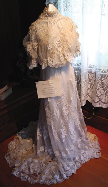 by: OUTLOOK PHOTO: CARI HACHMANN - A wedding dress from 1890 worn by the Harlow Houses first caretaker.