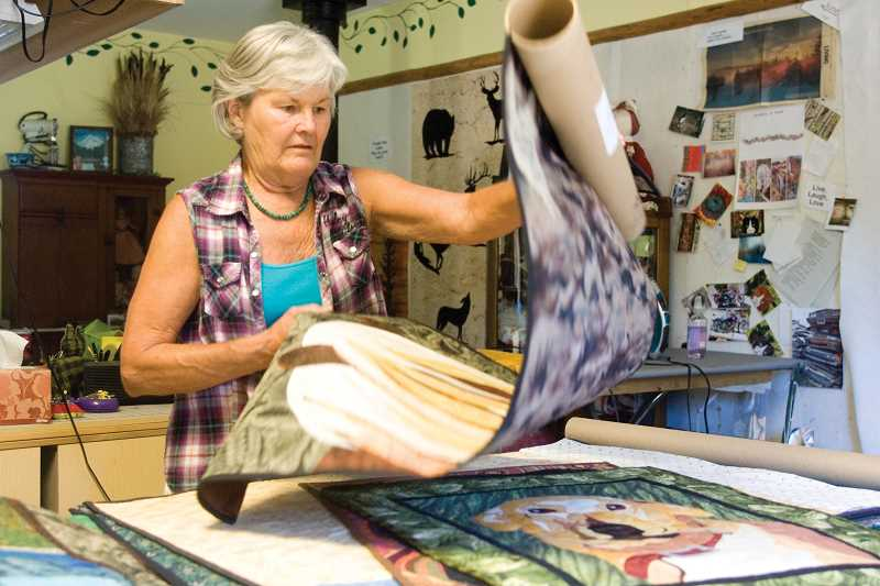 June Jaeger works in her studio, getting ready for the upcoming Sisters Outdoor Quilt Show.