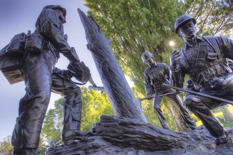 by: KEVIN SPERL - The bronze statue above is part of the Hotshot memorial at the west end of Ochoco Creek Park honoring those who lost their lives in the Storm King Mountain fire.