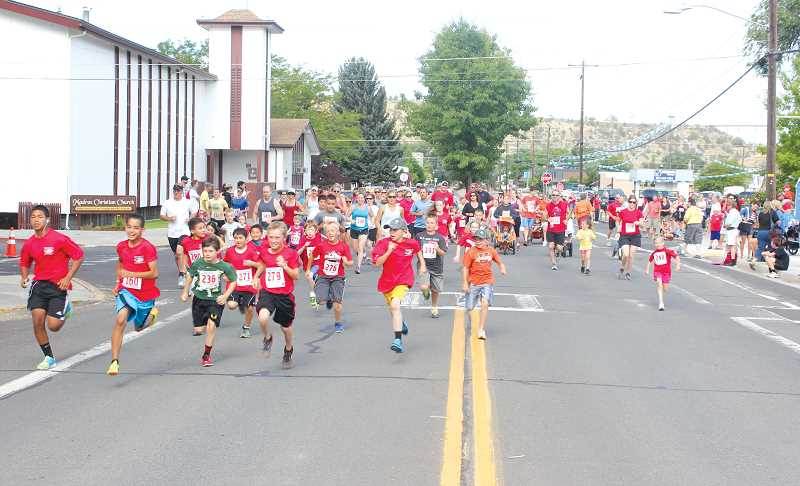 by: JEFF WILSON/THE PIONEER - A group of youngsters gets the Two Mile Fun Run off to a roaring start Friday morning during the Todd Beamer Memorial Run at Sahalee Park. The annual run drew a crowd of close to 200 participants in the three events this year.