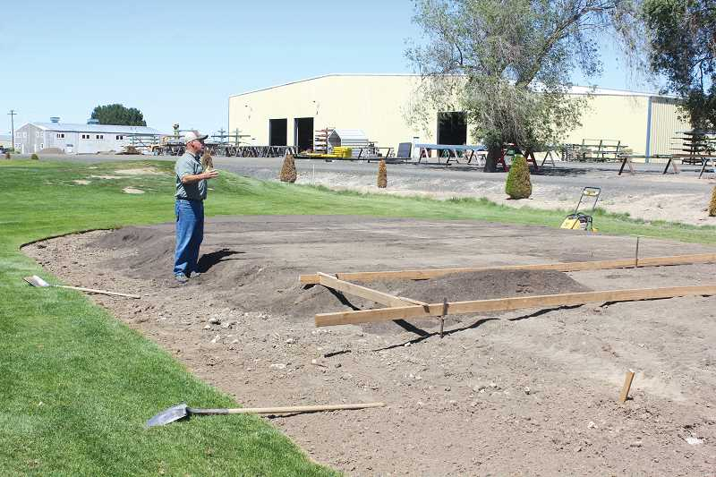 by: JEFF WILSON/THE PIONEER - Jonathan Burchell looks over the redesign of the tee box on the seventh hole at Desert Peaks. The new, longer box is part of a series of improvements to the golf course.