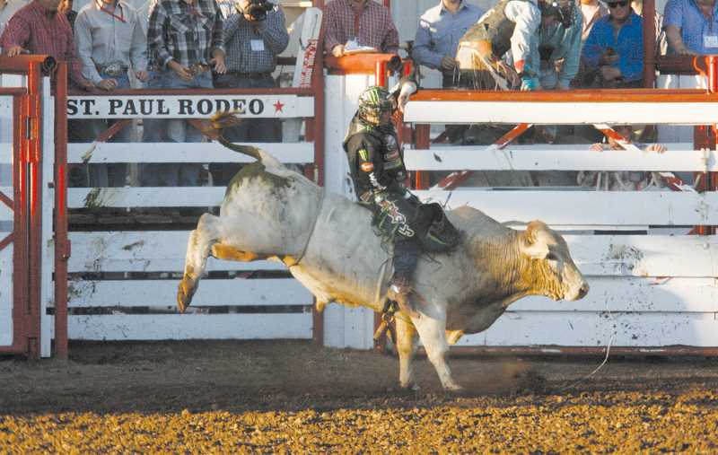 by: PHIL HAWKINS - L.J. Jenkins scored 87 points on his first go riding Rocky of Corey & Lange/Flying Diamond on his way toward a PBR victory July 1 at the St. Paul Rodeo