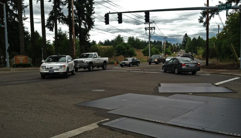 by: SPOKESMAN PHOTO: JOSH KULLA - Day Road in north Wilsonville is in a part of the city that falls in Washington County and could potentially benefit from a proposed county vehicle registration fee headed to voters in November.