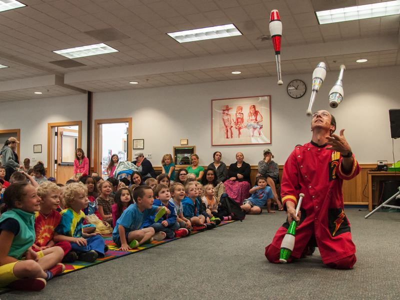 by: SPOKESMAN PHOTO: JOSH KULLA - Comedic juggler Rhys Thomas performs at the Wilsonville Library.