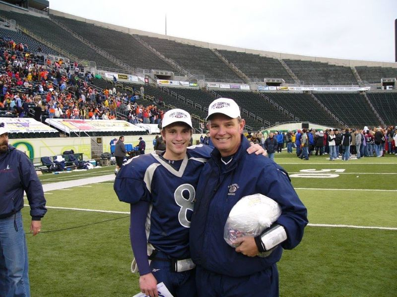 by: SUBMITTED PHOTO - George Crace and his son Spencer pose for a picture after winning the state championship in 2004.