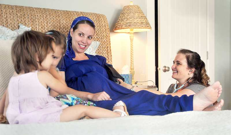 by: KATY SWORD - Alternative births - Jennifer Garlardo (right) offers full OB/GYN services to her patients at her new cottage birthing center near Dundee. This is her third center in the area.