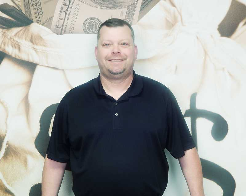 by: OREGON LOTTERY - Cash in hand - Newberg resident James Colburn won $100,000 in a Second-Chance lottery drawing earlier this month.