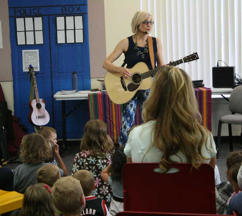 by: RACHEL LYNN ALDRICH - Greta Pederson leads a magical, musical afternoon at the Canby Public Library.