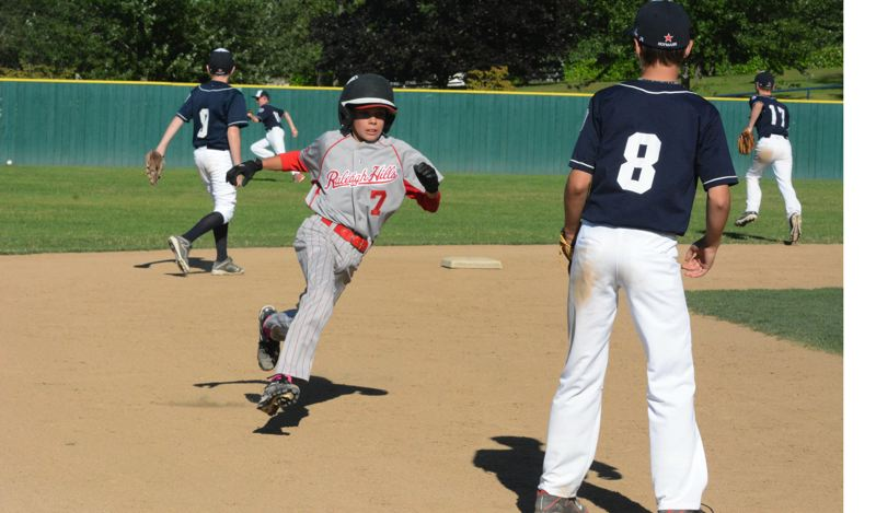 by: TIMES PHOTO: MATT SINGLEDECKER - Raleigh Hills Little League All-Star Curtis Posner rounds third base and heads for home in the third inning against Lake Oswego.