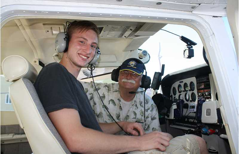 by: PEGGY SAVAGE - Jared Hartrampf, above, prepares to take off with pilot Robin Brooks in a Cessna. Jared was able to take the controls and fly the plane Tuesday.
