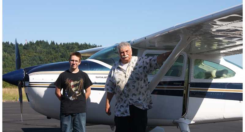 by: PEGGY SAVAGE - Tristan Hill, left, ready to fly a Cessna with Brooks