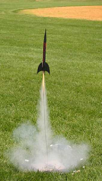 by: WIKIPEDIA - A model rocket launches from a community park.