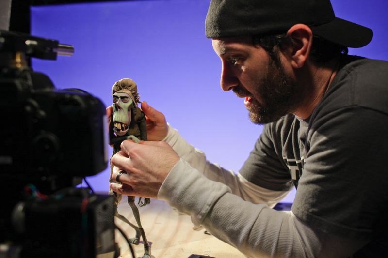 by: COURTESY OF LAIKA INC./FOCUS FEATURES - Animation supervisor Brad Schiff gets a zombie ready for a shoot during production of 'ParaNorman.'