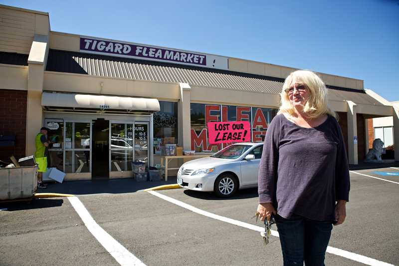 by: TIMES PHOTO: JAIME VALDEZ - Pam Benson stands in front of the Tigard Flea Market where shes been the manager for the past six years. The market closed its doors on Sunday, but Benson hopes to move the market to the Tigard Grange once a month