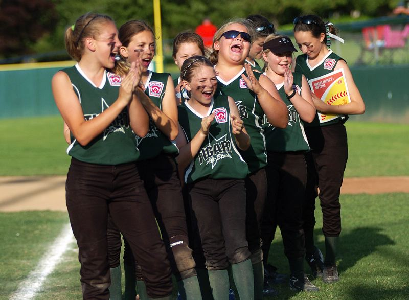 by: DAN BROOD - GOOD TIMES -- The Tigard Little League 10-11 all-star softball team shares cheers and smiles during the postgame celebration.