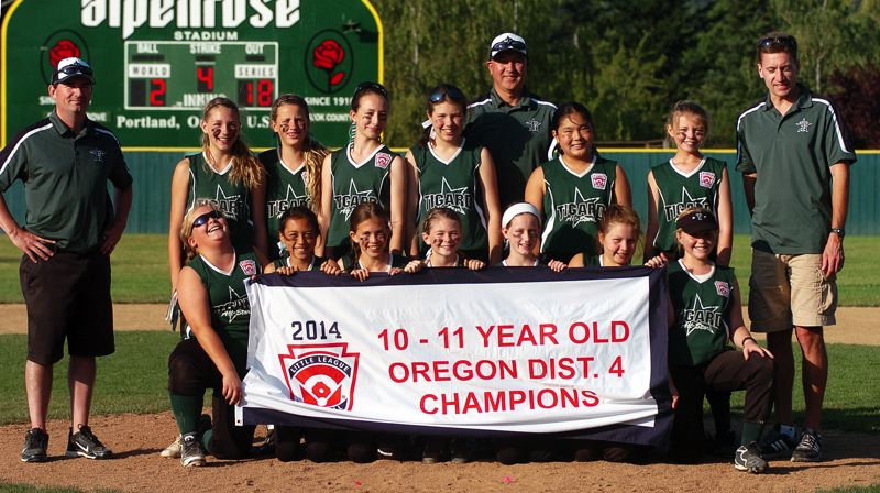 by: DAN BROOD - DISTRICT CHAMPS -- The Tigard Little League ages 10-11 all-star softball team poses with the District 4 championship banner following the squad's win over Forest Grove in the district tourney title game.