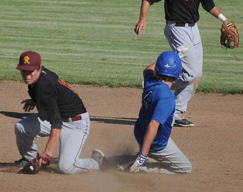 by: LON AUSTIN/CENTRAL OREGONIAN - Rowdie Dalton slides safely into second base in the first inning of the Cowboys' game with the Redmond Panthers. Dalton scored later in the inning, but it wasn't enough as the Cowboys lost 21-7.