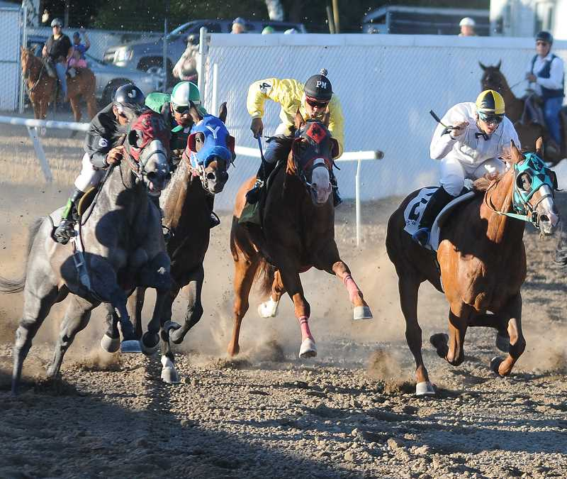 by: LON AUSTIN/CENTRAL OREGONIAN - Horses come out of the gate during the first race of this year's race meet. Sis Tar, ridden by Matthew Werner-Hagerty, won the 250-yard quarter horse race with a time of 13.983. Racing continues at the Crook County Fairgrounds through Saturday night.